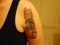 books-and-owl-tattoo-idea-on-arm