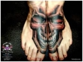 skull-tattoo-between-feet