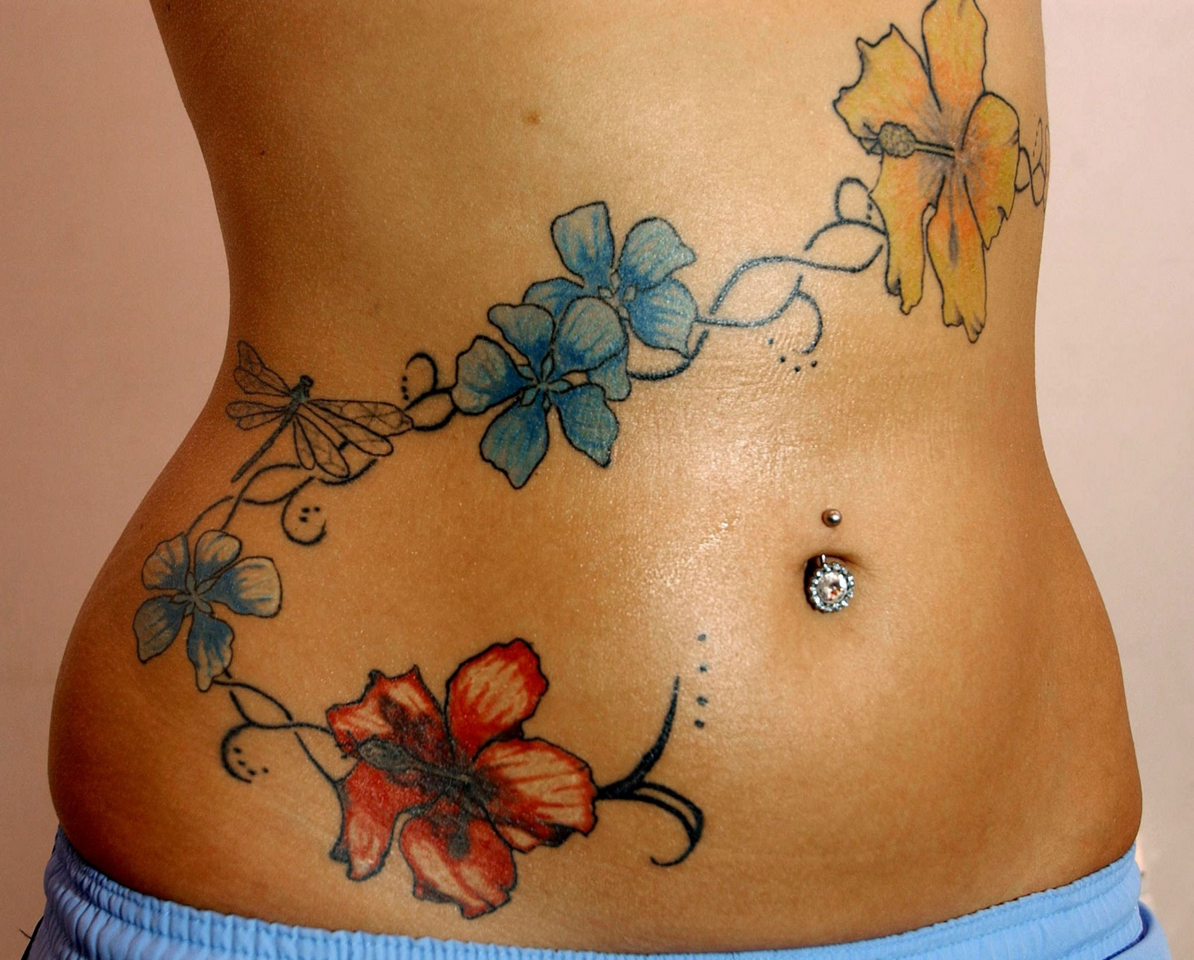 flower tattoos can come in different designs persons tattooing flowers